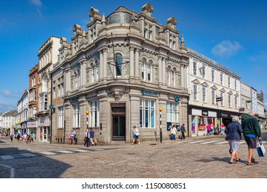 12 June 2018: Truro, Cornwall, UK - Shopping in the town centre, with Barclays Bank, on the corner of King Street and St Clement Street.