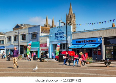 12 June 2018: Truro, Cornwall, UK - Lemon Quay, with the Pannier Market Hall and Cafe Nero.