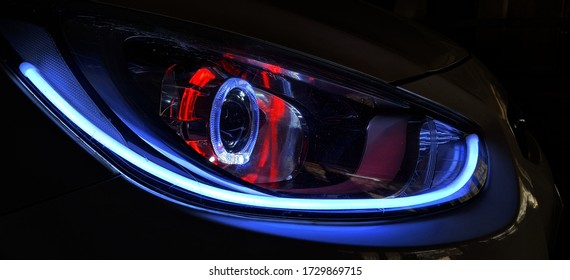 12 May 2020 10:23pm Pimpri-Chinchwad, India: A aftermarket modified car headlight with led.