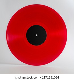 "A 12"" red vynil record with black label."