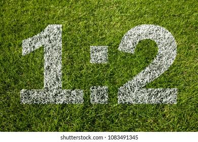 1:2 score on soccer meadow