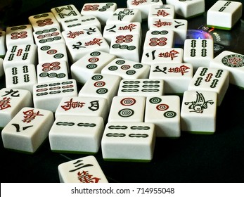 12 SEPTEMBER 2017, KUNMING: new Mahjong tiles of Chinese game played on a green table. illustrative editorial