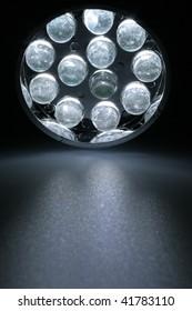 12 white LEDs shine on a surface.