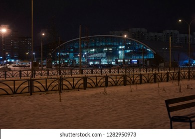 12.01.2019. Ekaterinburg city, Russia, night landscape, street with cars, shopping center building. Airship in the background. Botanical district