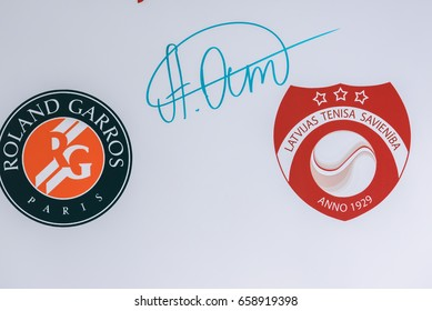12.06.2017. RIGA, LATVIA. Autograph of Jelena Ostapenko, French Open winner 2017 on wall. Jelena Ostapenko arrives in hometown Riga, Latvia. Riga International Airport.