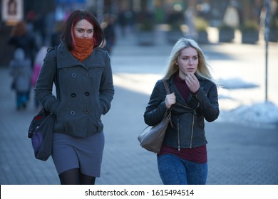 12-10-2018 Riga, Latvia happy girls in warm clothes walking in old town