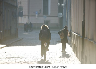 12-10-2018 RIga, Latvia Hipster on bike in the city at sunset. Without face