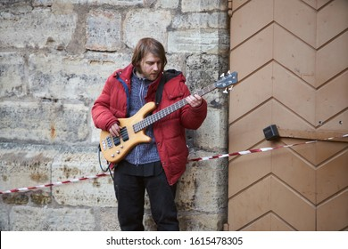 12-10-2018 RIga, Latvia Man playing guitar on the street. retro style.