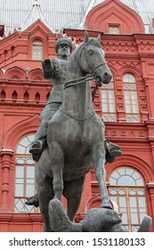 12-10-2019, Moscow, Russia. Monument to Marshal Zhukov on the Red Square. World War II commander Marshal Georgy Zhukov on a warhorse against the red brick wall of the Historical Museum