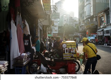 12/11/2017,the malaysia street of ho chi minh city,vietnam,the girl is selling the vietnam coffee to malaysia.