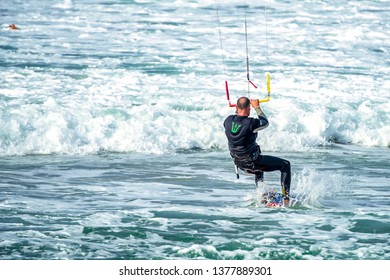 12/18/2018 Netanya, Israel, kitesurfing jumping over a surface of the Mediterranean sea over a parachute