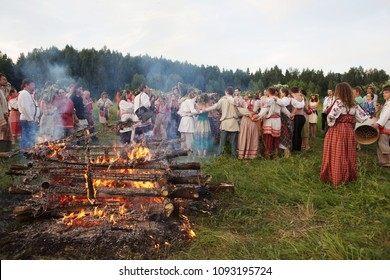 12_Istra. Russia.06.26. 2010.Festa Junina pagan holidays of the Slavs . Burning bonfire and round dance of people celebrating the national holiday of the Eastern Slavs, dedicated to the summer solstic