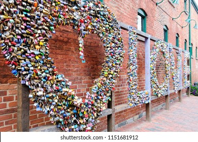 12th July 2017, Sweethearts leave a love lock at the Love Installation in the Distillery District in Toronto, Canada.