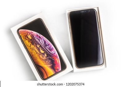 12th October,2018-Kiev,Ukraine: Latest Iphone XS in unopened box on white table. Newest Apple smatrtphone on white branded box in mobile store. Modern gadget with dual camera and OLED screen for sale