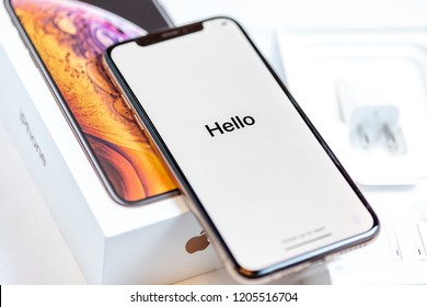 12th October,2018-Kiev,Ukraine: Latest Iphone XS on opened box on white table. Newest Apple smartphone on white branded box in mobile store. Edge frameless screen with loading Hello text