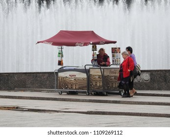12th of September 2017 -Scene from Moskovskaya Ploshchad (Moscow Square) with close up of a soft drinkl stand in front of the musical fountains,  Saint Petersburg, Russia