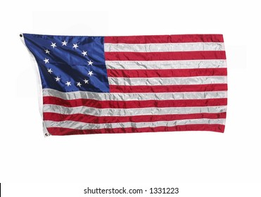 13 colonies flag of the United States of America, often called the Betsy Ross flag. The blue field in upper left has circle of 13 stars and there are 13 stripes