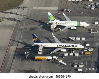 13 February 2017, Eindhoven Airport, Holland. Aerial view of Transavia and Ryanair  Boeing 737 at the gate with a Shell fuel truck.