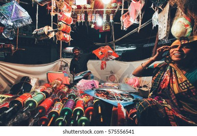 13 Jan 2015, Ahmedabad, India: Street hawker selling Kites for Uttarayan festival. Kite flying competition is main attraction of Uttarayan festival. Vintage style processing.