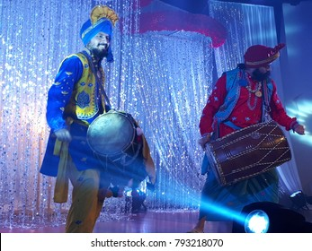 13 Jan 2018 Kuala Lumpur Malaysia. Performers performing bhangra dance during a Punjabi wedding dinner.