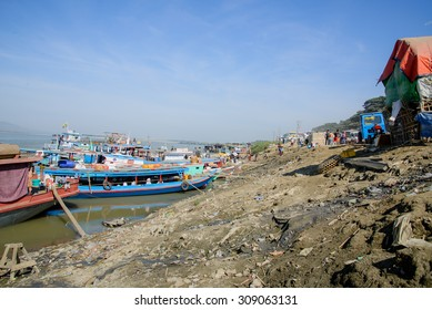 13 JANUARY 2015 - MANDALAY, MYANMAR - Tourist boats and ferries line the Irrawaddy River bank at Mandalay, Myanmar