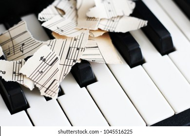 13 March 2018 Russia, Izhevsk. Close-up music score on piano keyboard, piece of paper, object
