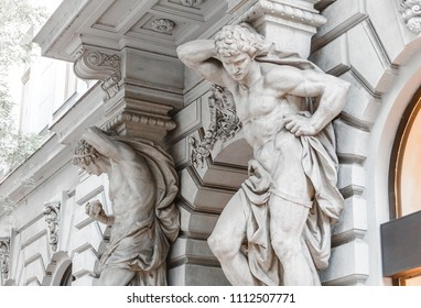 13 MAY 2018, BUDAPEST, HUNGARY: Statues of the Atlases holding an balcony
