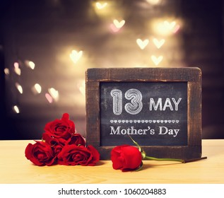 13 May Mothers day message on a small chalkboard with red roses