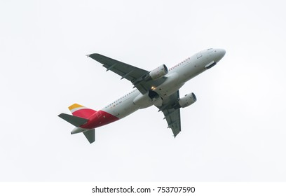 13 OCT, 2017 LONDON UK : airplane on white cloudy background. taking off. EC-IEG Airbus A320-214 Iberia A320 IB / IBE 3415CF