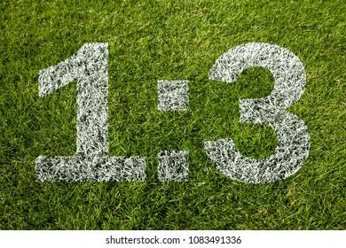 1:3 score on soccer meadow