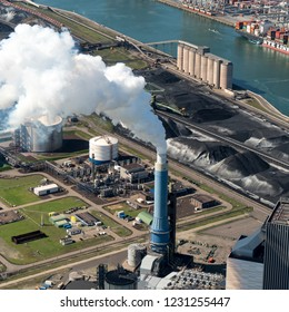 13 September 2018, Rotterdam, Holland. Aerial view of steel pipe with white smoke out of chimney at powerplant GDF SUEZ ENGIE at the Maasvlakte in the port of Rotterdam. Environmental pollution.