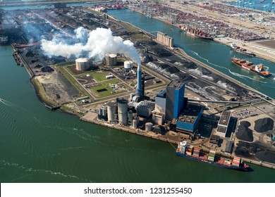 13 September 2018, Rotterdam, Holland. Aerial view of powerplant from GDF SUEZ ENGIE at the Maasvlakte in the port of Rotterdam. White smoke comes out of the chimney, environmental pollution.