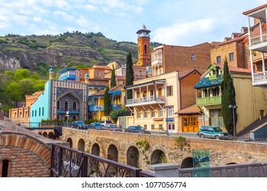 13.04.2018 Tbilisi, Georgia - Architecture of the Old Town of Tbilisi, Georgia, in Abanotubani area. Domes of sulfur baths, carved balconies.