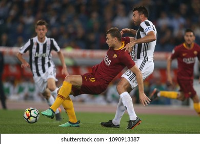 13.05.2018. Stadio Olimpico, Rome, Italy. Serie A. AS Roma vs FC Juventus.Dzeko and Barzagli  in action during the Serie A football match As Roma vs Juventus at Stadio Olimpico in Rome.