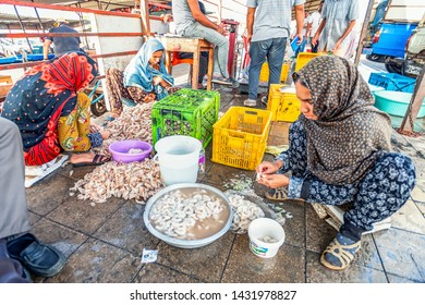 13/05/2019 Iran, Bandar Abbas, Hormozgan Province, youn women clean up and split shrimps in the traditional fish market on the Persian Gulf coast