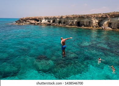 13.06.2019. Mediterranean Sea. Island of Cyprus. People jump in the sea from the rock