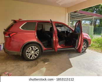 13.11.2020, Kuala Lumpur, Malaysia: Red Mitsubishi Outlander 2.4 Mivec, side view with open door. Photography of a stylish modern car on a parking.