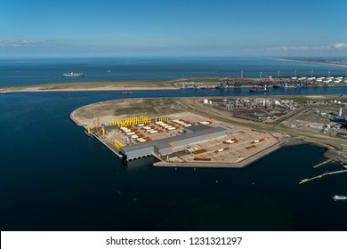 13-9-2018, Rotterdam, Holland. Aerial view of Tweede Maasvlakte with SIF Group in the front.  In the back Euromax Terminal and on the clear horizon a blue sky and the Noordzee with huge containership.
