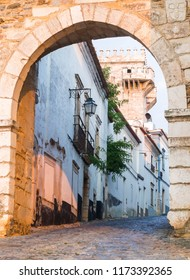13th century entrance to the Estremoz Castle in Estremoz, Portugal. Tres Coroas (Three Crowns) tower in the background.