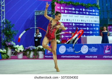 14 April 2018 Adriatic Arena,Pesaro ,Italy. Rhythmic Gymnast Linoy Ashram of Israel performs her ribbon routine during the FIG 2018 Rhythmic Gymnastics world Cup