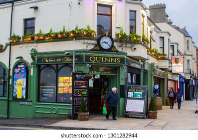 14 December 2018 A patron leaving Quinn's Traditional Irish Pub in Newcastle County Down after a few bevvies on a mid winter afternoon