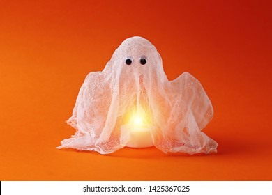 14 Diy Halloween ghost of starch and gauze on orange background. Gift idea, decor Halloween. Step by step. Top view. Process kid children Halloween craft. Workshop.
