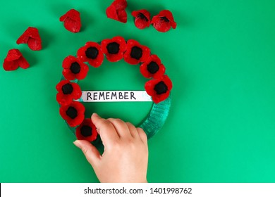 14 Diy wreath red poppy Anzac Day, Remembrance, Remember, Memorial day made of cardboard egg trays on green background. Gift idea, decor. Step by step. Top view. Process kid children craft. Workshop.