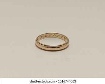 14 karrot gold wedding band. man's size 11 pure gold ring with lettering engraved on the inside.