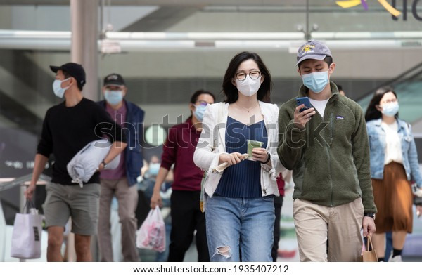 14 Mar 2021,Hong Kong.Citizens wearing the face masks on the street to prevent COVID-19 infection in Hong Kong
