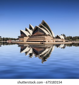 14 March 2014: Sydney, Australia - Sydney Opera House,viewed from a passing boat, reflected in Sydney Harbour.