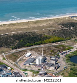 14 May 2019, Petten, Holland. Aerial view of ECN PETTEN, a nuclear power research station in the dunes of Holland with the Northsea in the background.  NRG produces cancer medicines.