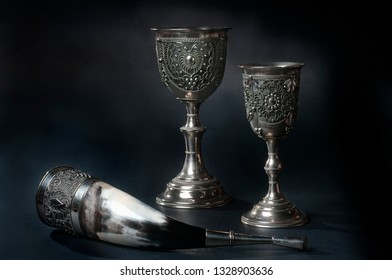 14 september 2016, Trieste, Italy. A georgian traditional drinking horn and drinking cups on dark background, close-up photo.
