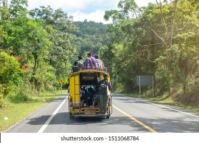 14 September 2019 , 10:05 am. THe passenger are going home by sitting inside or on the=e roof of local yellow taxi in the mountain of Doi Inthanon national park in Chiang Mai , Thailand.