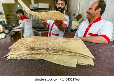14/05/2019 Shiraz,Fars ProvinceIran, bakers are baking Sangak bread in a traditional oven by traditional method, Sangak bread was traditionally the bread of the Persian army